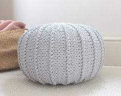 Something cute for you cozy home:) The pouffe is knitted with 100% cotton cord in a beautiful light grey color. Material: cotton cord, polystyrene stocking bag and polyester beans Dimensions: approx. 37-40cm/15-16 (Ø) x 25cm/10 (H)  I always try to describe my items as accurate as possible. I provide detailed information about used materials and the product dimensions. Please make sure that the item you would like to order meets your expectations. I always try to show the actual colors of my…