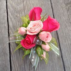 wrist corsage with hot pink and pale pink spray roses and lime hypericum and sequin ribbon @ Owens Flower Shop ~ Lawrence, KS