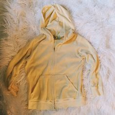Juicy couture terrycloth yellow zip up sexy hoodie Size large. Baby yellow color. Sleeves are 3/4 length. Love this jacket. Just downsizing. Juicy Couture Jackets & Coats