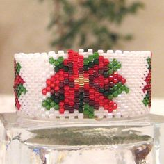 Beaded Poinsettia Tea Light Cover / Napkin Ring Pattern | Bead-Patterns.com Seed Bead Crafts, Beaded Crafts, Beaded Jewelry Patterns, Beading Patterns, Peyote Patterns, Seed Bead Flowers, Beaded Banners, Beaded Boxes, Beaded Christmas Ornaments