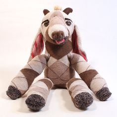 The Goat is the inspiration animal for this one-of-a-kind sock soft sculpture Sockamal. The little play buddy is made from upcycled socks, felt horns and vintage buttons. Pull on the tongue to make a Baaah!!! expression.    Sockamals are based on real life animals and can be used as teaching tools about these unusual animals and their habitats. These stuffed toys are not your traditional identifiable sock-monkey, so that children can free-associate and make them into their own imaginative…