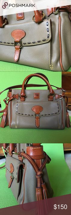 Dooney & Bourke handbag 9 x 12 x 5 medium sized pebble leather handbag in excellent condition. Bag has 4 inside pockets, one large zipper pocket and another large pocket with no closure on the same side.  There are also two smaller pockets on the opposite side.  Additionally there are two outside pockets, one that closes with a flap in front and one with no closure in the back.  No scratches, no stains. The long strap has been tailored and cut down to 24.5 inches to make it easier to carry…