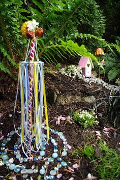 Here is such a cute Fairy Garden with amazing detail, including fairy houses, ponds and a MAY POLE!......adoreable....