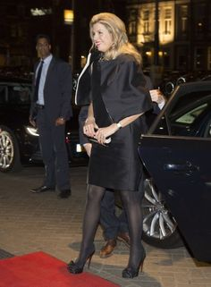 Máxima in a dress and coat by Natan. Click on the image to see more looks.