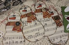 Christmas Crafts~  Snowman ornaments made from sheet music and a stripy scarf paper with a button