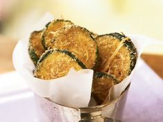 Breaded, oven-fried zucchini chips taste like they're fried, yet they are baked and amazingly crispy. These chips make a healthy...