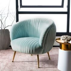 Capture the decadence and finesse of the Jazz Age with this chic shell accent chair. Crafted with chic curves, its ice blue top grain leather cowhide upholstery features chic ribbed pattern. Blue Velvet Accent Chair, Accent Chairs, Eames Chairs, Upholstered Chairs, Chair Cushions, Swivel Chair, Chair Pads, Single Sofa Chair, Barrel Chair