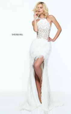 7ee3d599114 Metallic beadwork embellishes the modified halterneck bodice of this Sherri  Hill 51047 prom dress