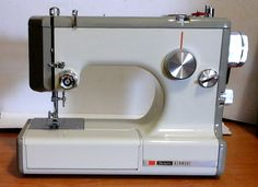 Tiny Kenmore 10400, a strong and fully functional, portable sewing machine.
