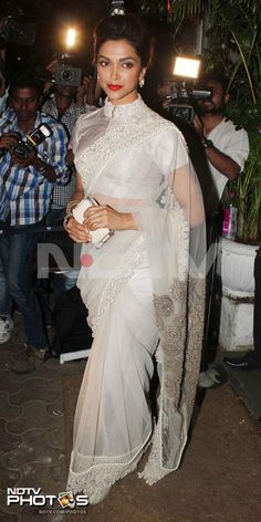 Deepika Padukone, who will next be seen in Sanjay Leela Bhansali's Ram Leela opposite Ranveer Singh, came dressed in a beige Anamika Khanna sari for the birthday party. The actress completed her look with red lips.