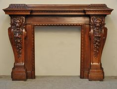 Large antique fireplace with lions heads carved out of oak wood...