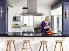Awesome hgtv kitchen decorating ideas with glossy dark table top feat stove also wooden bar stools and silver vent hood