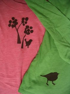 Freezer Paper Stenciling:   cut designs out of freezer paper with x-acto knives; Iron freezer paper onto plain shirts, shiny side down (with another piece of freezer paper shiny side up underneath the fabric). Brush on fabric paint, let dry overnight. Peel freezer paper; Heat-set the designs with an iron.