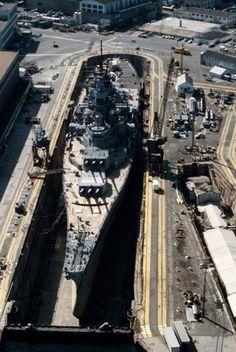 An aerial view of battleship USS Iowa (BB-61) in Dry Dock No. 4 at Norfolk Naval Shipyard 1 May 1985.