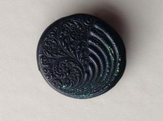 Glitter swirl brooch in jewel enamel £6.00