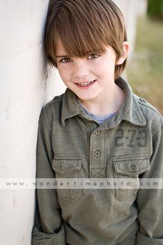 Family photo session in downtown Tucson, Arizona with one of my returning clients who are so much fun to work with! Check out this child's big brown eyes! www.wondertimephoto.com