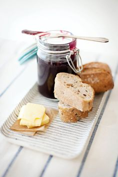 Grape + Rosemary Jam 2 1/2 lbs. Grapes 2 1/2 lbs cups sugar 1 1/2 Tbs lemon  juice Rosemary Sprigs  Separate pulp from skins of grapes. Chop skins in blender. Cook skins  gently 15 to 20 minutes, adding only enough water to prevent sticking  (about 1/2 cup).  Cook pulp without water until sof