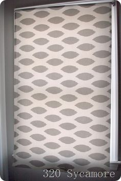 Decorated roller blind...I've done this, but fabric is definitely not the way to go, anyone thinking of doing this please consult me, I can save you a lot of headaches...trust me!