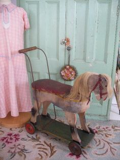 little wooden horse on wheels
