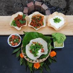 It's the final #freshlyblogged challenge! Lara Johnson serves up succulent fall-of-the-bone pulled pork with coriander and bean sauce accompanied by tortilla bowls and all the best Mexican toppings: guacamole, tomato salsa, sour cream and refried beans #picknpay #recipe