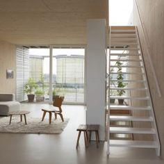 A Room with a View by MeesVisser is an Amsterdam home overlooking the IJ river  steel frame - wood paneling : three months building time