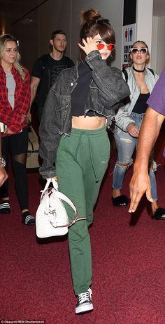 0c997fa6bf18e Selena Gomez flashes her toned tummy in cut off tank top in Tokyo