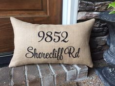 This is exactly what your front porch has been waiting for. These burlap address pillow covers are one of a kind and no one in your neighborhood will have one like it. This listing is for one burlap pillow cover. This burlap pillow cover is handmade using premium natural colored burlap fabric on both sides. The numbers and street name are machine embroidered onto the fabric. Choose your size cover 16x16, 12x16 or 12x20. Each cover has an invisible zipper in the bottom for easy insertion and… Burlap Fabric, Burlap Pillows, Cotton Fabric, Throw Pillows, Pillow Inserts, Pillow Covers, Colored Burlap, Personalized Pillows, House Numbers