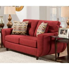 The Killington loveseat is a contemporary style loveseat covered in an ultra soft performance fabric. Tufted back cushions, wood peg legs, and toss pillows accent this loveseat. Loveseat with two toss