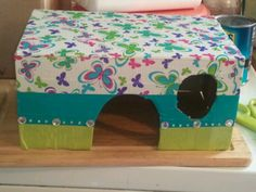 DIY guinea pig house Cut the top off an old shoebox Cut out a door big enough for your little guy or gal and a window....they are little peppers Decorate with duct tape and there you have it!