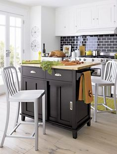 Kitchen tip: Adding a butcher block island and tall chairs creates a central workplace for meal preparation.