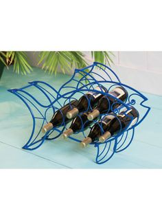 Blue Metal Fish Wine Rack for $79.00 from  WineRacks.com  Dimensions: 26w x 7.5 d x 17.5 h Capacity: 6 bottles  Stores your wine just swimmingly! Bright blue metal wine rack holds 6 bottles.