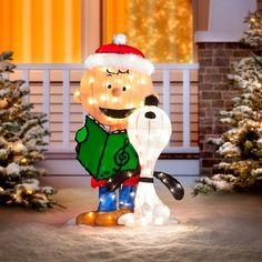 our charlie brown and snoopy caroling lighted outdoor christmas decoration sings the praises of the season