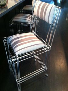 I heart lucite!...I'd do a more feminine fabric but this chair ROCKS