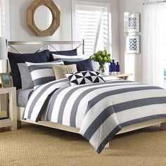 Sail away to dream land with this navy duvet cover set from Nautica. This machine-washable cotton set includes one duvet cover and two shams for a cohesive look on your bed. Navy, blue and white strip
