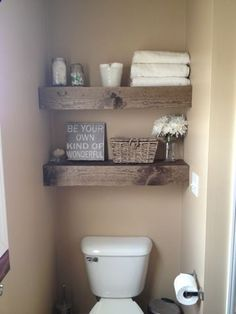rustic shelves with white towels, white flower pot, mason jars of cotton balls, q-tips, flowers?????