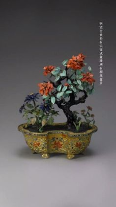 Imperial pomegranate bonsai made of coral and gemstones in gilt bronze pot, Qing Dynasty. Collection of China National Palace Museum, Beijing