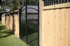 Craftsman-style wood privacy fence with custom aluminum double swing gate Wood Privacy Fence, Wood Fence Design, Double Swing, Fencing Companies, Good Neighbor, Western Red Cedar, Mossy Oak, Central Florida