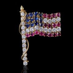 ae616dabd1de Elizabeth Taylor s yellow gold brooch designed as the American flag and set  with diamonds