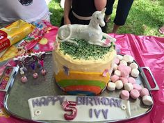 Our Ivy's 5th Birthday cake.  She badly wanted a unicorn so I gave her one.  My very first fondant unicorn :)