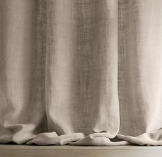 puddled linen curtains (drapes)