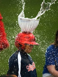 Catch the Water Bomb Toss-colander attached to helmet. Good wet fun. Multiple outdoor games at this link.