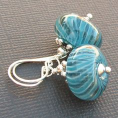 Good for all those leftover lamp work beads in my studio. Quick and easy!
