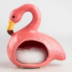 Crafted of ceramic with a painted finish and embossed feathers, our trendy sponge holder adds your favorite pink wading bird to your sink area. The holder's generous opening has room for multiple spon