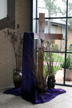 Lent- cross with purple cloth- vases of dry sticks/branches