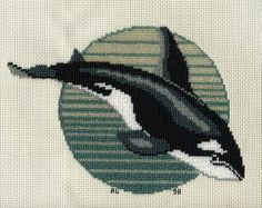 Cross stitched pattern designed by Gail Schornak, Sitka, Alaska.  I used this pattern of the Orca whale and instead of DMC floss I used all Mill Hill beads on vinyl-weave 14 count cross stitch fabric for a 3 ring binder cover.