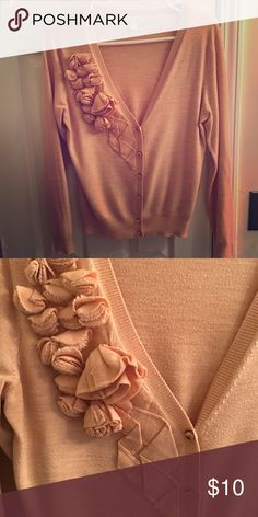 Peach flower cardigan sweater Peach colored cardigan sweater flower on chest and decorative buttons. Perfect for the office or date night. Very slight wash wear, but only if you are up really close. Looks great on. New York & Company Sweaters Cardigans