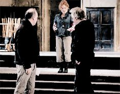 It looks as if Alan Rickman is getting some sort of instructions ... perhaps from a director ...?