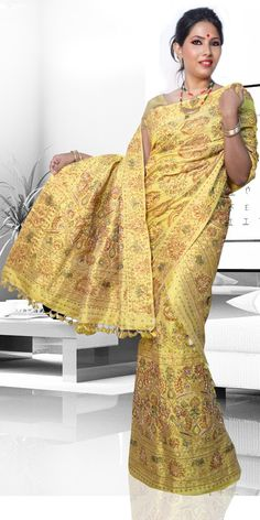 Beautiful Yellow colour Assam Silk Pat Mekhla Chadar. This is a traditional Wedding collection with artistic chumki work.The set is outlined with Naksi Stone and thread.This is a three piece set i.e.Chaddar, Mekhala and Blouse Piece. The Mekhla Chadar comes with matching blouse piece, the blouse shown in the image is just for display purpose.Slight colour variation may be there in display  actual.