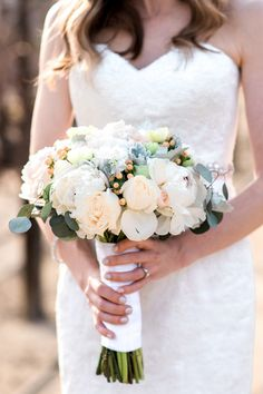 Ivory bridal bouquet idea -  pale peach roses, peonies and berries  {Mink Photography}