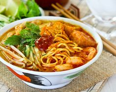 Curry Laksa is a tasty and spicy Malaysian coconut based curried noodle soup topped with shredded chicken, shrimps, fried tofu, and bean sprouts.